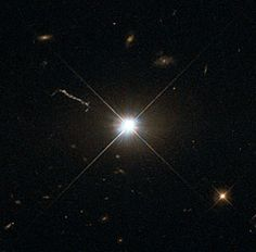 This image from Hubble's Wide Field and Planetary Camera 2 (WFPC2) is likely the best of ancient and brilliant quasar 3C 273, which resides in a giant elliptical galaxy in the constellation of Virgo (The Virgin). Its light has taken some 2.5 billion years to reach us. Despite this great distance, it is still one of the closest quasars to our home. It was the first quasar ever to be identified, and was discovered in the early 1960s by astronomer Allan Sandage.