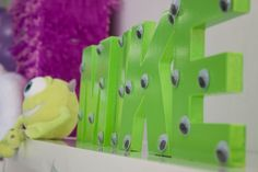 Birthday Kids name with Eyes glued on to it...Monsters Inc Party Decorations