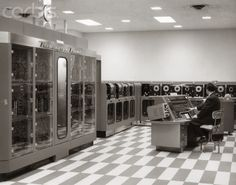 Programmer In Data Processing Room with Remington Rand Univac Computer and Tape Drives.