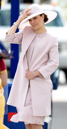 Crown Princess Victoria wore almost the same colour as her future sister-in-law, though she added a hat and coat to her outfit.