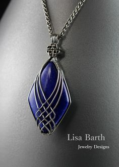 Here is a version of the criss cross wire wrap thingie I do. I must say that the symmetry on this one is a bit tough to get right without chewing up the wires. The Lapis Lazuli is absolutely gorgeous, so rich and luxurious.