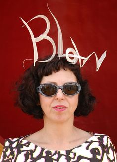 The late Isabella Blow in a hat by Philip Treacy .