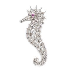 1920s Diamond Seahorse Brooch. Pavé diamond seahorse brooch mounted in platinum with a ruby eye.American, ca. 1920