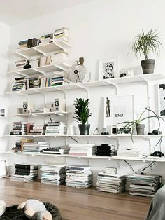 Kelly: craft room upstairs idea. Let's do full height shelves that are clean and sleek, but within reach of the kids and provides some interesting organizational ideas. magazines, books on the floor in stacks, art tools above, etc etc