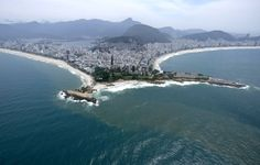 FILE - This Oct. 9, 2015 file photo shows the beaches of Ipanema, left, and Copacabana, right, in Rio de Janeiro. The 2016 Olympic Games will be held in Rio de Janeiro. (AP Photo/David J. Phillip, File) ORG XMIT: NYET109