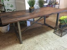 Solid Walnut Table, with a X metal frame base. With a rustic solid walnut top this table is absolutely breathtaking in person. We offer a lifetime