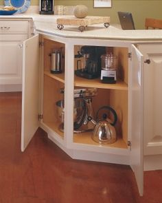 Turn useless corner space into maximum storage space where large bowls and dishes fit perfectly. By Thoamsville Cabinetry.