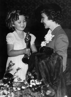 "1934 Shirley Temple presents CLAUDETTE COLBERT with the Best Actress Oscar for ""It Happened One Night"""
