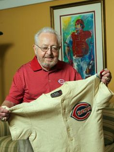 Journey back to 1953 MLB All-Star Game with Bernie Stowe. Photo: Bernie Stowe, longtime Cincinnati Reds equipment manager, with the uniform shirt he wore as a bat boy at the 1953 All-Star Game at Crosley Field. Behind him on the wall is a print of Johnny Bench by Leroy Neiman. The Enquirer/Patrick Reddy