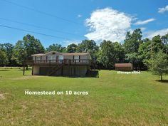 Private setting 10 acres m/l, clean 3 bed, 2 bath mfg. home, perm. foundation poured concrete walk out bsmt. UL Open floor plan, all appl. stay & w/d. Split plan, master private ba.& lrg. closet. Propane gas frpl in LR. Wood deck on main. LL double overhead garage door, workshop, 5,000 gal. emergency water tank, safe room, storage galore. Shipping container, shed, 20x36 barn dirt floor aprox 2 ac. wire fenced w/2 gates, sec. system in Yellville AR