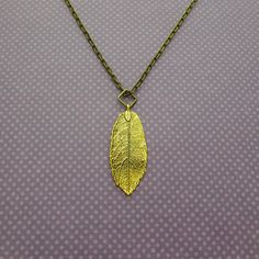 long gold leaf necklace by juliethefish on Etsy