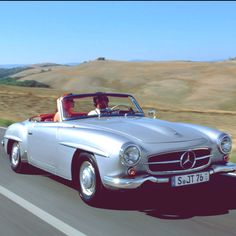 Classic Mercedes on the open road. Great day for a ride !