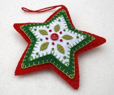 Red and green felt star Christmas ornament. Handmade felt hanging star with embr. - Red and green felt star Christmas ornament. Handmade felt hanging star with embr. Handmade Christmas Decorations, Felt Decorations, Christmas Ornaments To Make, Christmas Sewing, Handmade Ornaments, Handmade Felt, Felt Ornaments, Christmas Projects, Holiday Crafts