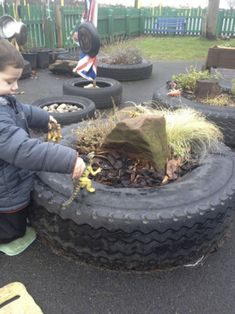 Trail of tires with different items in each. Very cool!