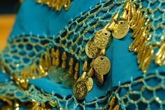 Moroccan scarf in turquoise, with fringe made of gold glass beads, faux gold metallic coins, and nice crochet detaling.