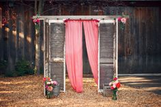 a ceremony backdrop homemade from shutters and a vintage ladder