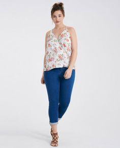 "<p>These ultra comfy jeans feature a soft denim body, a super stretchy fit, a 2-button design, and a roll cuff hem.</p>  <p>Model wears a size 14.</p>  <ul> <li>Mid-Rise</li> <li>Zip Fly / 2-Button Closure</li> <li>26"" Inseam</li> <li>13"" Leg Opening</li> <li>75% Cotton / 23% Polyester / 2% Spandex</li> <li>Machine Wash</li> <li>Imported</li> </ul>"