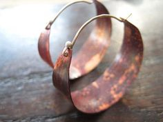 """These sweet, petite hoops make great """"every day"""" earrings. They are sterling silver on the outside and brass on the inside. Hammered and oxidized. Sterling ear"""