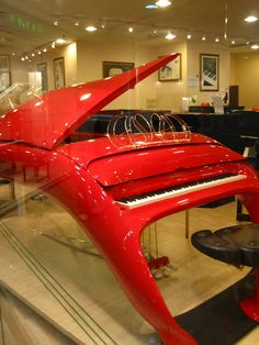 Schimmel Pegasus Futuristic Grand Piano. Ummm.......yeah. I'll just stay with the old school, thank you!!