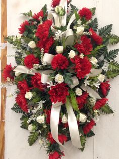 Red and white standing funeral spray by Kelly