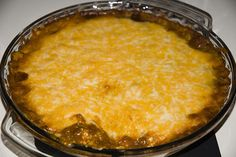 "3 ingredient dip... A recipe stolen from an ex-boyfriend's ex-girlfriend. Is now known as, ""The Dip"". 1 package cream cheese (bottom layer) 1 can Chili (no bean), I prefer Hormel (middle layer) As much shredded cheese on top as you would like. Bake in oven, any temp really, till bubbly all around....."