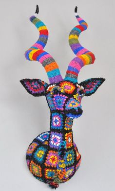 Designed by South African designer Magda van der Vloed, this spectacular trophee is made out of hand-crocheted plastic bags.