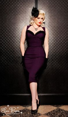 Masuimi Dress in Deep Plum from Pinup Couture - Pinup Couture turns up the volume on our classic wiggle silhouette with amazing body enhancing details and our high-quality stretch bengaline fabric. Bust cups are built in and framed with lace trim, and the seaming is strategic to cinch in your waist line and emphasize your best features! Double kick pleats and zipper finish up the back for a dress as sexy as Masuimi herself.