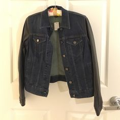 Ann Taylor denim jacket with faux leather sleeves NWT Ann Taylor dark blue denim jacket with black faux leather sleeves. Silver hardware. Never worn and in perfect condition. Ann Taylor Jackets & Coats Jean Jackets