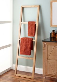 The Stokes Teak Ladder Towel Rack comfortably holds your bathroom towels and linens. Its ladder-style design is a charming addition to earthy bathrooms.