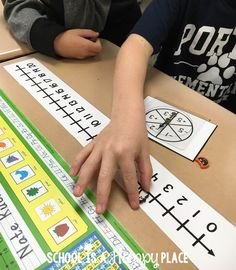 Number line spinner game for counting on and back