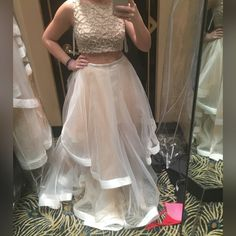 Iso this dress Terani Couture. two piece i need it in a size 2 or 4. i want that bottom and i know the top comes in different styles. im open to any of them. need it to be in clean condition and not missing beads. dont want to spend anymore then $300. ISO HELP ME FIND Terani Couture Dresses