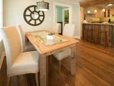 How To Build a Reclaimed Wood Dining Table: This humble yet classy dining room table combines wood, glass and natural elements. Description from pinterest.com. I searched for this on bing.com/images