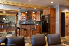 rustic hickory kitchen cabinets | Cabinets: Rustic hickory inset cabinets in a comfortable wet bar
