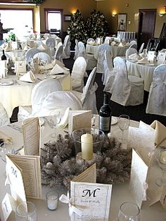 White damask chair covers with white organza sash.  Winter wedding at Lynx Ridge Golf Course.
