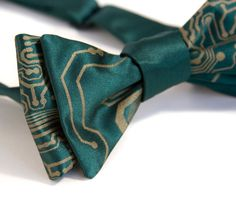 Everyone knows you're smart, now show off that even smarter wardrobe with this bow tie! We offer unique ties printed from real vintage circuit board screens.