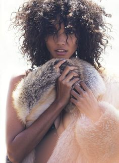 Cora Emmanuel Hits the Beach in Fur for Elle