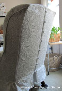 Beautiful slip-covered chairs with buttons up the back