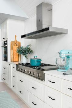 The light and bright kitchen at HGTV Dream Home 2018 with white Shaker cabinets and handsome wood-topped island has a clean and contemporary style with a user-friendly open layout. Bright Kitchens, Home Kitchens, Coastal Kitchens, Coastal Farmhouse, Interior Modern, Kitchen Layout, Kitchen Decor, Kitchen Ideas, Kitchen Designs