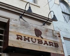 commerial rustic metal sign - Google Search  like the idea of wood and letters.  Hanging exterior sign idea