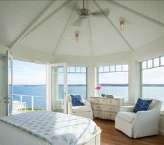 "Beach Style Providence Cottage I could give up on any luxurious bedroom for a bedroom with this kind of view! I absolutely love the feeling of freedom and expansiveness this space offers.  Lighting is from ""Circa Lighting""."