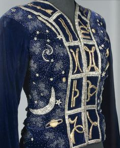 Presented in 1938 the Zodiac Collection, the jacket features Elsa Schiaparelli's trademark design of the Big Dipper, which was her good luck emblem.  A nickname given to her by her astronomer uncle, Giovanni Schiaparelli, he observed that Elsa had beauty marks correlating to the group of stars.  The jacket sold at auction has the twelve glyphs of the zodiac running along its opening and neck, with planets, comets and constellations embroidered over its midnight blue hue.