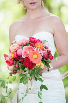 Mix dahlias, marigolds, mums, spray roses, and stock in vibrant, saturated colors for a whimsical look!