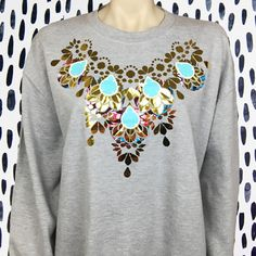 This Grey slouchy fit sweatshirt is embellished with African fabric applique panels, a shiny gold mirror print and pale blue teardrops. These sweatshirts are popular year round as they make stylish Christmas jumpers AND colourful cover ups for chilly evenings in the festival fields. Applique Fabric, Christmas Jumpers, Grey And Gold, Recycled Fabric, African Fabric, Unisex Fashion, Grey Sweatshirt, Printed Cotton, Fields