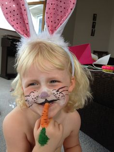 Rabbit face painting - with finger carrot!
