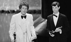 Schneider and Hearts and Minds director Peter Davis, with their Oscars on April 8, 1975. Bert holds the telegram from the Provisional Revolutionary Government of Vietnam that scandalized the audience.