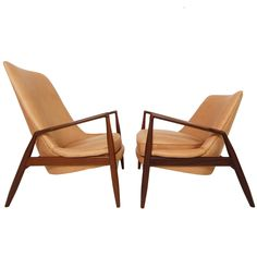 Stunning Pair of Ib Kofod Larsen His and Hers Leather Seal Chairs | See more antique and modern Lounge Chairs at http://www.1stdibs.com/furniture/seating/lounge-chairs