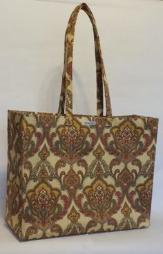 """Market Euro Tapestry in print 152 India. Canvas hand bonded to a drapery print. It measures 15.5"""" x 12.5"""" x 6"""" There is a slight flair to the pin tucks. There will be only two bags made in this print. This bag is available for purchase. Gold nylon liner, metal feet, magnetic snap closure."""
