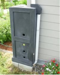 rain barrel - squarish to fit the house. Great for an urban garden