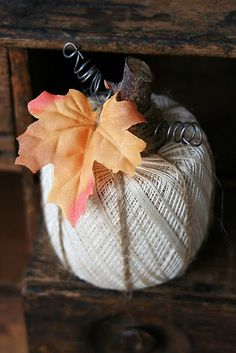 Way cool! I see these embroidery spools at thrift stores everywhere. But I would leave out the fake leaves.