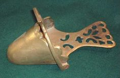 An Antique Brass Sidesaddle Slipper Stirrup
